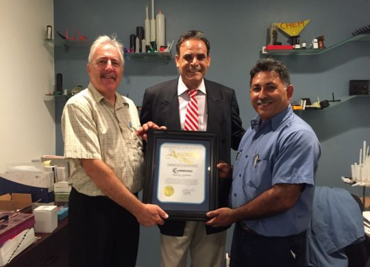 Ricardo Benitez (center) from Assemblymember Patty Lopez's office presented Greg Leighton (left) and Jesus Hernandez (right) with a certificate of recognition.